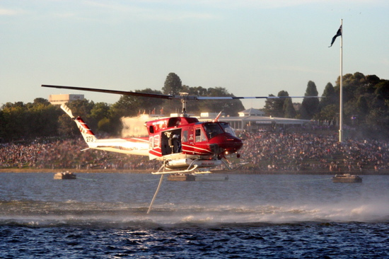 Firefighting chopper filling up in Lake Burley Griffin